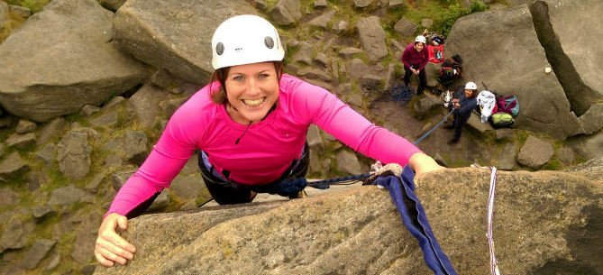 Image of a woman rock climbing in the peak district