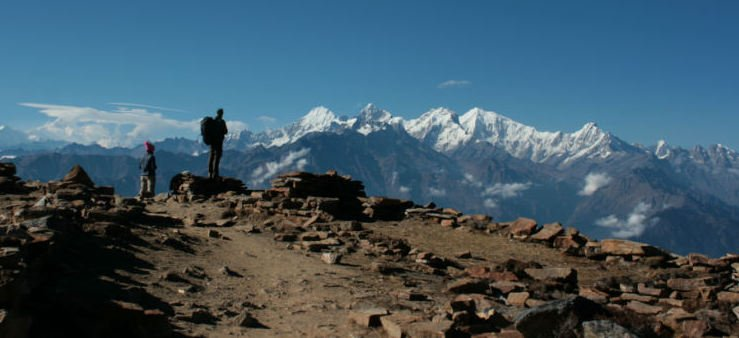 image showing a trekker enjoying the view whilst on the Langtang Trek
