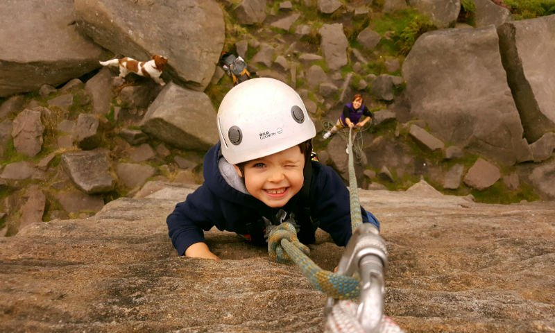 Image of a boy rock climbing in the Peak District