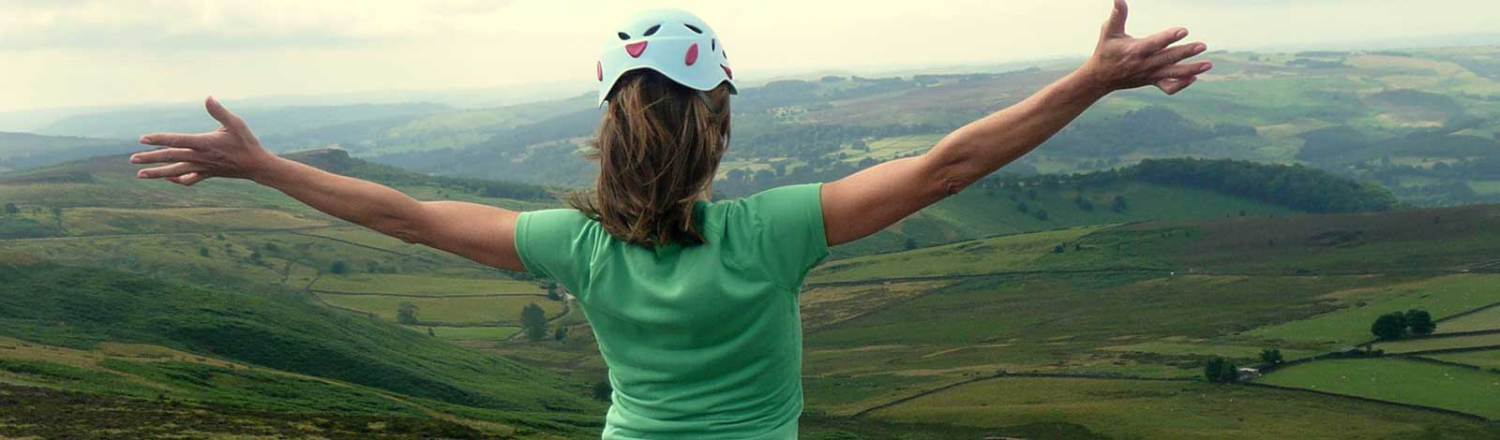 Image showing a lady embracing the view from Stanage Edge having overcome her Fear Of Heights