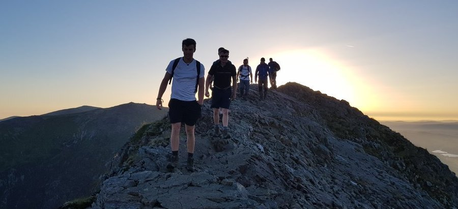 image showing a group traversing Crib Goch in Snowdonia on the Welsh 3000s challenge