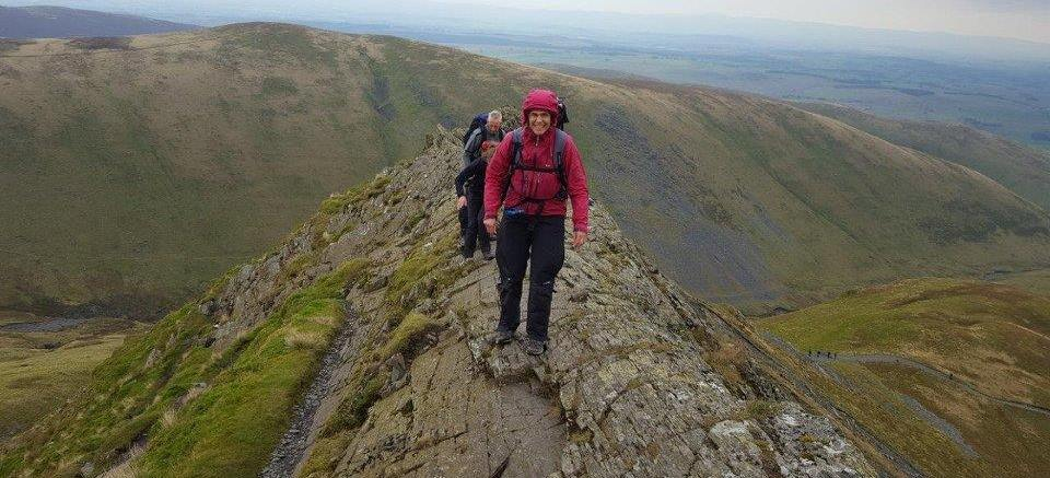 image showing walker traversing Striding Edge