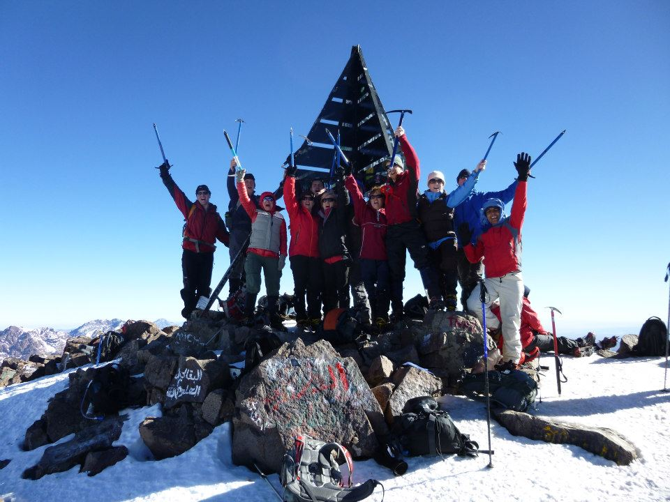 image showing a team of trekkers celebrating summit success on Jebel Toubkal Morocco