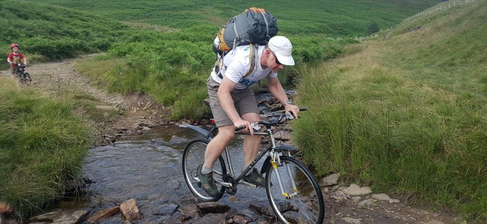 image showing a mountain biker in the Peak District